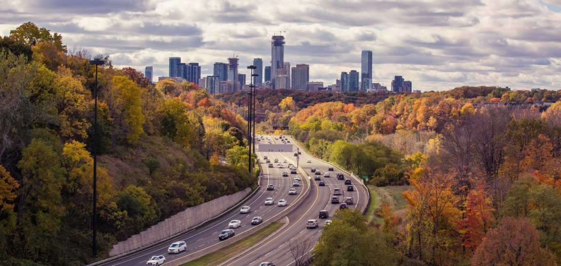image of cars on highway in city in the fall